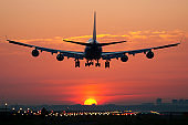 Airplane landing with sunrise