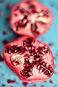 Close-up of pomegranate on messy cutting board