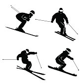 Four silhouettes of skiing persons