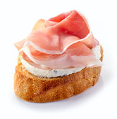 toasted bread with cream cheese and prosciutto