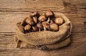 Fresh Harvest Mushroom in Vintage Burlap Bag.