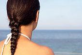 Sun Cream on a Woman's Shoulder
