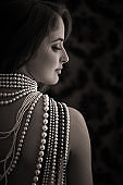 young woman wearing pearl necklaces