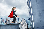 Businesswoman About To Leap Tall Buildings