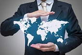 Businessman standing posture hand holding world map isolated