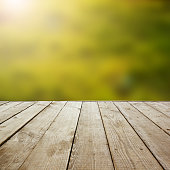 Wooden perspective floor with planks on blurred background