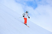 Men snow skier skiing on sunny ski resorts  Winter sport