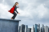 Superhero Businesswoman In Red Cape Attempting To Take Flight