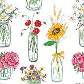 Seamless pattern of mason jars with flowers