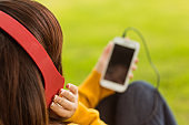 Close up of woman enjoying music in park