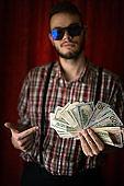 young man posing with usa dollars