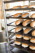 Bread rolls on trays of shelf