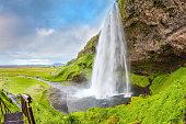 Seljalandsfoss waterfall in warm July day