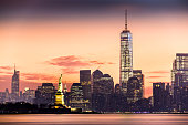 Lower Manhattan and the Statue of Liberty at sunrise