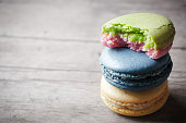 eat of macaron closeup on wooden