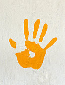 Orange handprint on a wall
