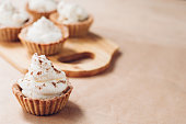 Little homemade oat tarts with whipped cream