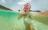 Half-in half-out underwater selfie