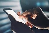 Closeup of hands using smartphone