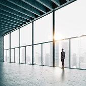 Business man looking at big city