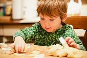 Little boy making cookies