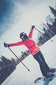 Skier With Arms Outstreched at the Mountain