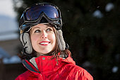 Young Woman With Helmet and Ski Goggles in Winter Time