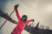 Woman Skier With Arms Outstreched at the Mountain