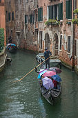 Venetian gondola on rainy day, Venice, Italy