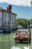 The water taxi nicknamed 'Amore' is docked, Torcello, Italy