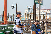 Gondolier waiting for tourists, Venice, Italy