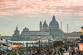 Gondolas tourists and Santa Maria della Salute, Venice, Italy