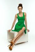 Beautiful woman in green dress