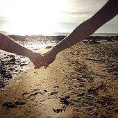 Holding hands at the beach