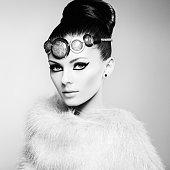 Glamour women in fur cape