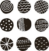 Black and white print with decorative circles.