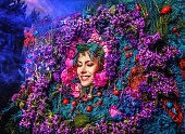 Fairy tale girl portrait surrounded with natural plants and flowers.