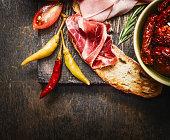 bruschetta or crostini with italian ham and antipasto , close up