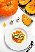 Seafood with pumpkin garnish. White diet  fish with pumpkin and