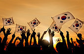 Silhouettes of People Holding Flag of South Korea