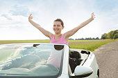 Woman Raising Hand In Car