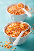 raw healthy red lentils in bowls