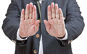 stop sign by two palms - businessman hand gesture