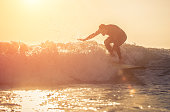 Young surfer practicing surf in Manhattan beach, california
