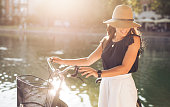 Attractive woman with bike at park