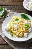 Pasta with mozzarella and basil