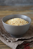 Sesame fried in a bowl on the boards