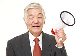 senior Japanese businessman with megaphone