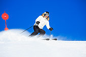 Men snow skier skiing enjoying on perfectly prepared ski slope