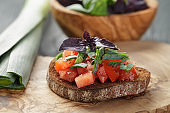 homemade bruschetta with tomatoes, basil and leek